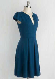 Delight taste-testers left and right as you dole out your perfectly blended punch in this teal-blue dress. With a V-notched neckline and pleated, flared skirt, this cap-sleeved frock makes you feel as effervescent as your carefully crafted libations.