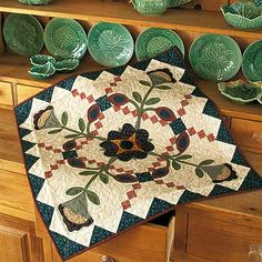 Country Garden, this is an adorable miniature quilt!