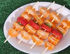 Fruit kebab with honey dipping sauce for summer cook out. Love!
