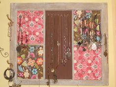 Window Framed Jewlery Holder - Old window frame I found in my shed.. Simple white wash and brown wash technique. Cut each panel individually then hot glued and stapled fabric to panels before nailing to window frame. Found old coat hanger hooks spray painted desired colors, and used bulldog hooks for the jewelry hangers.