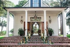 Southern Small White Chapel with Brick Steps and Wooden Doors https://www.thecelebrationsociety.com/weddings/elegant-lowcountry-wedding-inspiration-montage-palmetto-bluff-bluffton-south-carolina/
