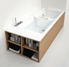 A drop in tub in a wood housing.  Storage is nice too!
