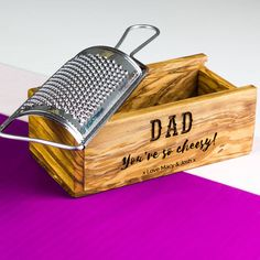 A beautifully crafted personalized cheese grater with olive wood box. Made from Italian stainless steel and sustainably sourced Italian olive trees. Grate (sorry, pun intended) for all types of cheese or zesting any citrus fruit. All caught in the stunning olive wood box...so no mess!