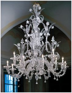 """Murano Ca Rezzonico 7061K8+4 style chandeliers in clear glass with gold details, milk white with gold leaf color or completely in clear glass. There is a handcrafted traditional Venetian Murano chandelier, lighting fixture and extraordinary Murano glass artwork as one completed by genuine Murano master. Murano glass chandelier lighting fixture with 12 light arms. Dimensions: Ø 55.2"""" (140cm) X h 65"""" (165cm) Bulbs: 12 x 40W or 60W – 110v E12 bulbs"""