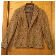 BROWN LACE BLAZER SIZE S BROWN LACE BLAZER IS EFFORTLESS TO WEAR AND HAS A FANCY BUTTON CLOSURE. THIS GARMENT IS LIGHT WEIGHT AND IS COMFORTABLE OVER YOUR FAVORITE TEE OR TANK TOP. THERE IS A FAUX POCKET ON EITHER SIDE. UNDERARM TO UNDERARM MEASURES 18 1/4 INCHES. SHOULDER TO BOTTOM OF GARMENT 23 INCHES SLEEVES 24 INCHES. Last Kiss Jackets & Coats Blazers