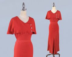 1930s Gown / 30s Red Orange Crepe Full Length Dress / Capelet Sleeves! / Bias Cut by GuermantesVintage on Etsy https://www.etsy.com/listing/597146034/1930s-gown-30s-red-orange-crepe-full