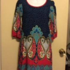 Just Funky sheath dress with pocket made in side A boutique dress that is very pretty with vibrant  colors . Lhasa 3/4 inch sleeves . Length is 32 1/2 inches. Slip on over head .100% viscose . Just Funky Dresses