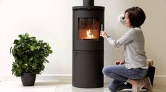 "http://exodraft.co.uk/   ""No more sooty glass, smell of smoke or prolonged lighting.  Install an exodraft chimney fan and take control over the fireplace. You get perfect fire and you can enjoy the fireplace or the wood burning stove all season without any problems. """