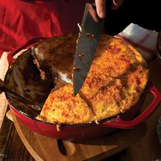 Moussaka; a baked casserole of eggplant, zucchini, tomatoes, and minced lamb or beef under a lush layer of béchamel sauce