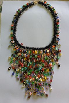 Seed bead necklace with Daisy Seed Bead Necklace, Seed Bead Jewelry, Diy Necklace, Handmade Jewelry Designs, Handcrafted Jewelry, Handmade Necklaces, Beaded Bracelet Patterns, Homemade Jewelry, Fabric Jewelry
