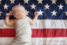 Michelle Morris created the ultimate Fourth of July photo shoot by simply swaddling a baby and placing him on the flag. Easy to copy at home to commemorate baby's first Independence Day, the photo is one for the memory book.   Source: Michelle Morris Photography