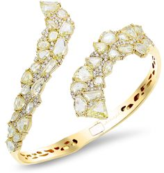 Bangle bracelet in 18k yellow gold with 13.42 cts. t.w. rose-cut and 1.14 cts. t.w. round brilliant diamonds, $63,000; Michael John Jewelry