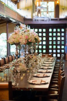 The Cooper Estate. Miami, FL. Wedding venue. Long table. Pink & white flowers. Tall centerpieces. Chandelier