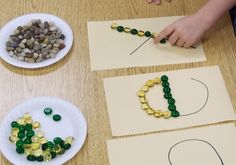 outline letters with pebbles, also good for fine motor development