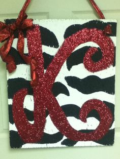 My favorite out of them all! Same thing just Ceiling tile, paint, & glitter :)