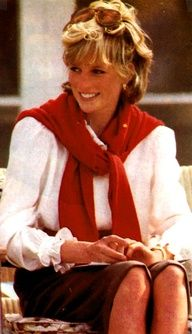 Diana looking smart in a crisp white blouse, skirt and red sweater