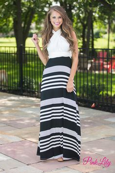 We adore this gorgeous black and white maxi dress! Featuring a variety of horizontal stripes, a white bodice, and an elegant wrap style, this maxi stands out in a crowd! It's perfect for your next formal event - just add wedges and a statement necklace!