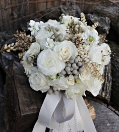 milky way roses,majolica spray roses, white stock, pieris japonica, ranunculus, and silver bruniaberries ~ Alicia Jayne Florals