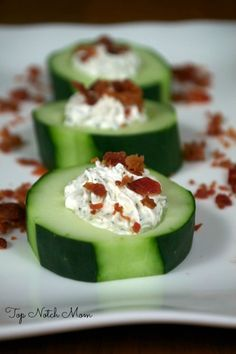 Stuffed Cucumber Cups:  5-6 long cucumbers ,  1 (8 oz) package cream cheese - softened ,  1 (16oz) container sour cream ,  2 TBS Dill Weed ,  1 TBS Dried Minced Onion ,  1 TSP Celery Salt ,  6-10 strips bacon - crumbled