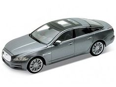 Jaguar XJ Saloon Diecast Model Car by Welly This Jaguar XJ Saloon Diecast Model Car is Metallic Grey and features working wheels and also opening bonnet with engine, doors. It is made by Welly and is scale (approx. Jaguar Xj, Jaguar Models, Diecast Model Cars, Scale Models, Toys, Vehicles, Die Casting, Engine, Wheels