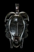"""Senufo - in literature this mask type is called """"kpelié"""", which comes from the Senufo word for """"jumping"""". A generic term in later research is """"kodal"""". The masks are used at funeral ceremonies. Their job is to displace the spirit of the deceased out of his house. They belong to the """"poro"""" men society, an organization based on various age groups, which have to perform social and political control, impart traditional knowledge and fullfil various religious functions. For the """"small legs"""" aside…"""