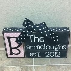 Made this using: wood blocks, scrapbook paper, ribbon and vinyl I cut out with my cricut :)