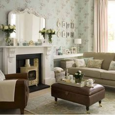 Modern vintage living room log burner and brown sofa with plae decore