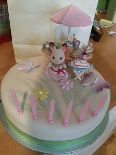 Granddaughters birthday cake using sylvanian rabbit.