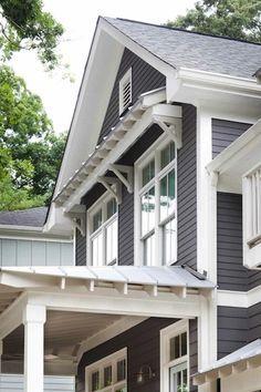 light grey roof with dark grey siding, white trim