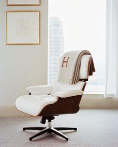 Two design classics - the Eames lounge chair and the Hermes Avalon blanket.