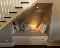 cozy reading nook under the stairs