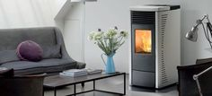 A Nordic Fire pellet fire place in a living room. Pellet Fireplace, Decoration, Stove, Home Appliances, Living Room, Wood, Home Decor, Stoves, Electric Fireplaces