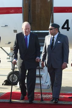 King Mohammed VI of Morocco (R) receives King Juan Carlos of Spain (L) at the Rabat Sale airport on 15 July  2013 in Rabat, Morocco