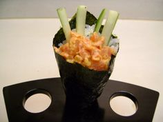Spicy tuna hand roll in a hand roll stand