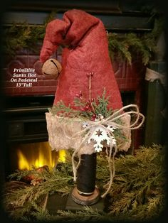 Primitive Santa Hat On Wood Pedestal (Made In USA)  This would make a great topper  for the Christmas tree.