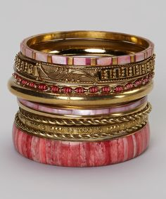 Another great find on #zulily! Gold & Coral Twist Bangle Set by Fantasy World Jewelry #zulilyfinds