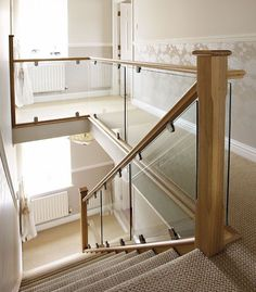 I love this contemporary oak & glass ballustrading on this stairway - makes a real impact to any modern hallway.