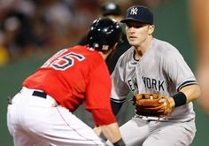 BOSTON, MA - AUGUST 1: Stephen Drew #33 of the New York Yankees confronts Dustin Pedroia #15 of the Boston Red Sox forcing Pedroia out of the base path for the out in the 7th inning at Fenway Park on August 1, 2014 in Boston, Massachusetts. (Photo by Jim Rogash/Getty Images)