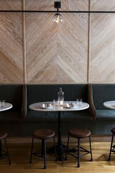 Steel Factory-Style Windows and Doors Trend alert. The East Pole Restaurant in NYC features a chevron-paneled wall; photograph by Nicole Franzen. The East Pole Restaurant in NYC features a chevron-paneled wall; photograph by Nicole Franzen. Restaurant Design, Architecture Restaurant, Deco Restaurant, Interior Architecture, Restaurant Seating, Restaurant Banquette, Stockholm Restaurant, Restaurant Lighting, Restaurant Interiors