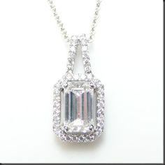 Striking emerald cut diamond halo pendant necklace with diamond striking emerald cut diamond halo pendant necklace with diamond stati jewellery by sundas ikram pinterest emerald cut diamond emerald cut and aloadofball Choice Image