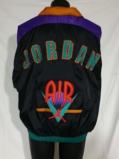 Very cool vintage Nike Air Jordan with hidden zip, hood jacket! Flight, Hip Hop, Track, Windbreaker style mans M. Beautifully sewn applique work. Exceptional condition.  #Usewearwant where the elegant, the unique, culture, and style mingle to party!