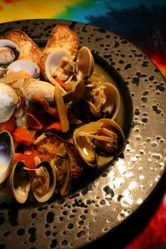 Green New Zealand Clams with Candied Ginger, Kula Tomatoes, Scallions, Red Pepper Flakes and Reisling; Sourdough Toasts