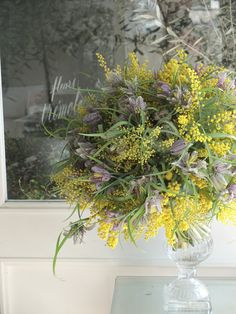 Light airy yellow and purple arrangement