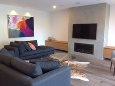 The lounge room. I love this room. Concrete feature wall created by SKY high Renderers.