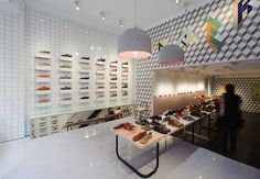 Trend: Infusing local flavor into retail spaces to create relevancy. Camper store by Tomás Alonso, Santander (pictured) - Spain - has a minimalist design with local flavor, allowing the shoes to be the hero while creating a connection with their local clientele. This one is their latest.