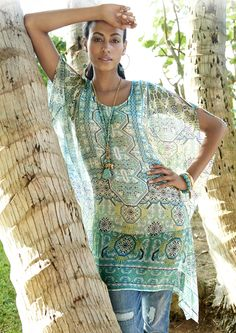 Here's a quick way to dress up your look: this sheer caftan. It's just like a poncho, but longer.