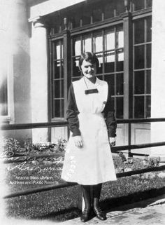 Photograph of Katherine Clark Brallier in Harvey Girl uniform standing outside Fray Marcos Hotel in Williams (Ariz.) :: Arizona Archives Historic Photographs