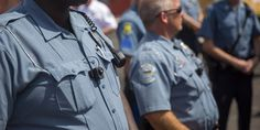 Members of the Ferguson Police Department wear body cameras during a rally on Aug. 30, 2014, in Ferguson, Missouri. Police in Ferguson were outfitted with cameras as a reaction to protests over the shooting death of Michael Brown, an 18-year-old un...