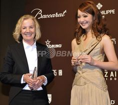 German designer Jil Sander (L) and Japanese model Nozomi Sasaki pose for the press during the 53rd awards ceremony of the Fashion Editors' Club of Japan (FECJ) at a hotel in Tokyo on April 27, 2010. Sander was awarded the FECJ Designer of the Year and Sasaki received the Model of the Year  AFPBB News