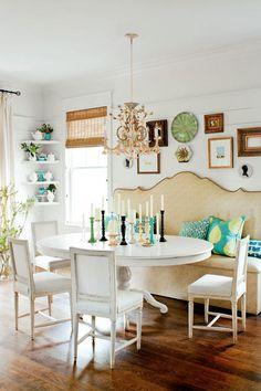 "Dining Room - Christmas Staycation - Southernliving. A custom banquette made of faux-ostrich vinyl sheds spills in the dining room. ""This is a mess-proof spot for kids,"" says Seleta."